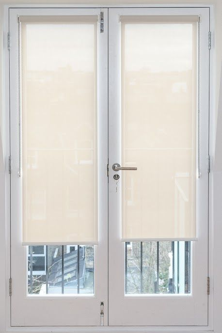 Sunscreen roller blinds fitted to french doors. http://www.theblindshop.com