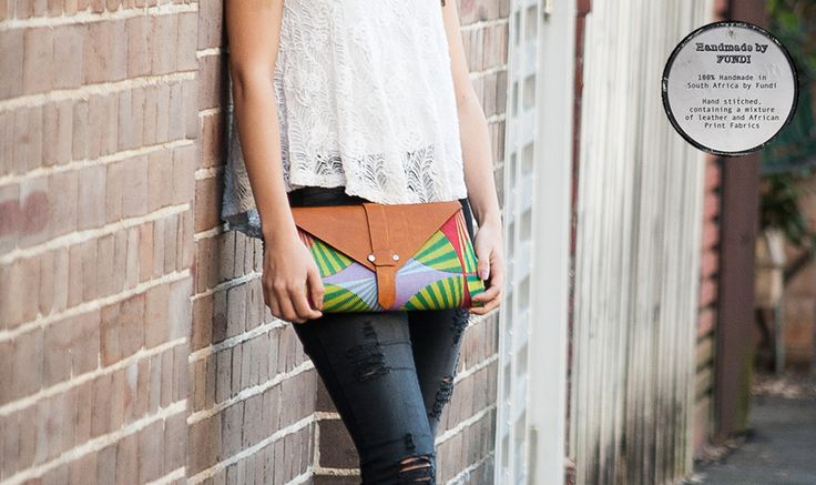 Layla, a gorgeous hand crafted hard shell clutch made with a large array of African fabrics, no two bags are alike. Each is as unique as you.