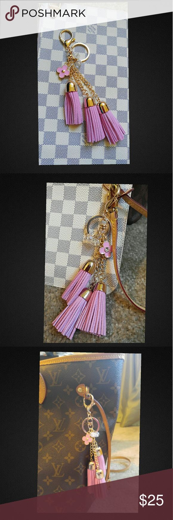 Rose ballerine pink purse charm keychain bag charm New rose ballerine tassel pink purse charm bag charm keychain. No brand, just a cute accessory for your purse. So pretty! Rhinestone crystal in the center of the flower, two crystal like balls, and three tassels. Will look pretty on any Louis Vuitton purse, I set it next to the damier azur, damier ebene, and monogram print to show it's versatility. Tags: Louis Vuitton, MCM, Coach, Michael Kors, Celine, Chanel, Gucci, Tory Burch Louis Vuitton…