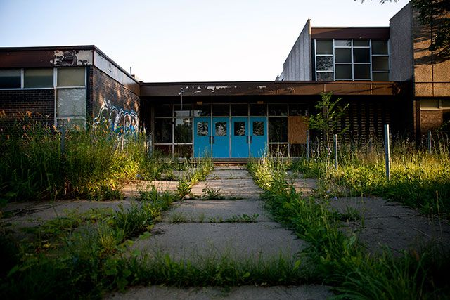 Weeds and grass overtake the run-down Campbell Elementary School, one of the many closed schools in Detroit, July 19, 2013. Betsy DeVos, Trump's nominee for secretary of education, argued that the Detroit's public schools should simply be shut down and the system turned over to charters. (Photo: Nathan Weber / The New York Times)