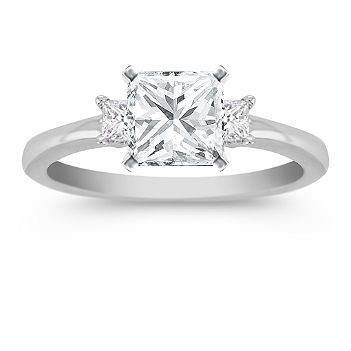 Hand-matched for exceptional brilliance and fire, these two princess cut diamonds are approximately .19 carat total weight. Both of these exquisite stones are set in quality 14 karat white gold and await the center diamond of your choice. Shown with a center stone Princess Cut Diamond.