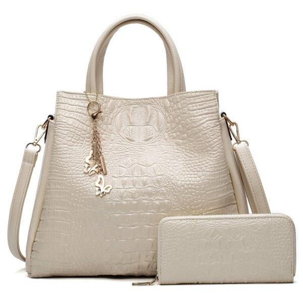 ed879733bbc4 Product Description  This crocodile embossed handbag set contains a tote bag  and a zip around