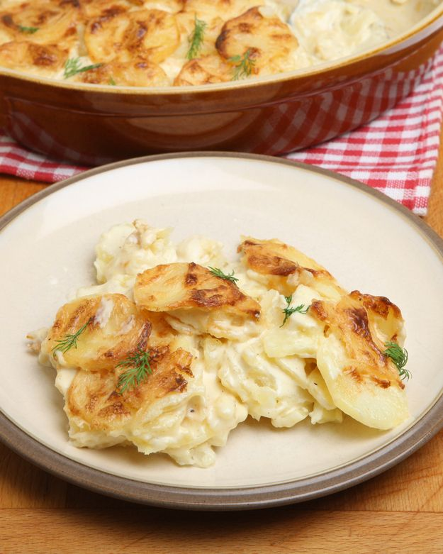Gratin Dauphinois  doesn't have any cheese. It is just made of sliced potatoes baked in milk, or cream.