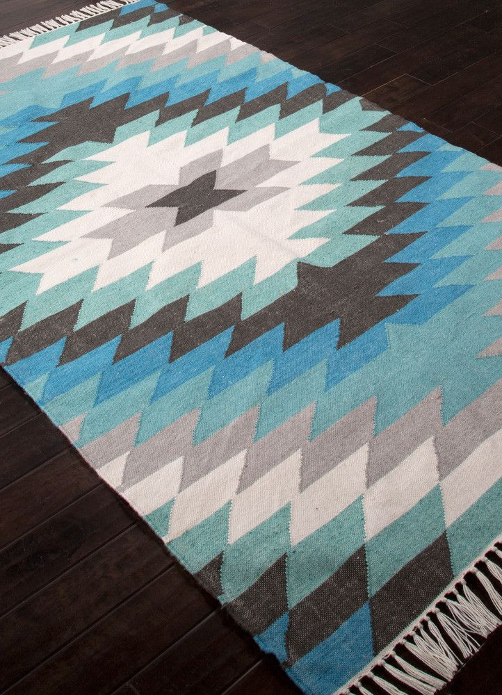 This indoor outdoor flatweave is inspired by the traditional kilims of the desert region, with both warm and bright colors. - Color: Blue/Gray - Material: 100% Polyester - Shipping: Ships within 5-7 d