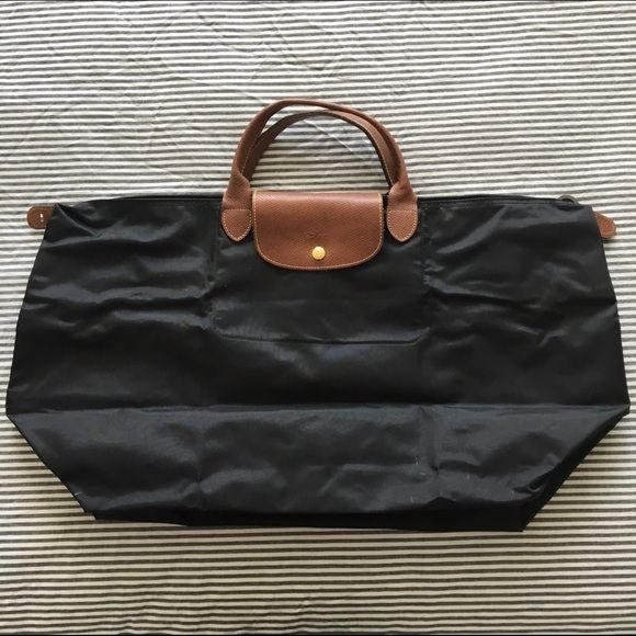 NOT FOR SALE Longchamp Extra Large Travel Bag Very, very good condition Le Pliage black extra large travel bag from Longchamp. I used this bag less than 5 times. It is a great size for weekend trips, though I have managed to use it for a whole week! It is also great for packing in your suitcase in case you go shopping on vacation. The only signs of wear are a few small white marks on the bottom of the bag - they could wash off, but I haven't tried. Longchamp Bags