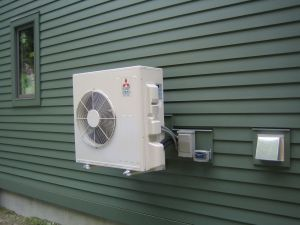 Yesterday our heating contractor installed the exterior unit of the air source heat pump (ASHP) system. Our system is part of the Mitsubishi Mr. Slim product line. It is referred to as a mini-split…