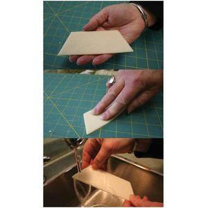 This cleaner removes fleece and flannel lint and batting fibers from your cutting mat. Use a brushlike stroke with the angled edge and it will