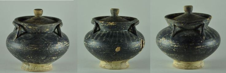 Greek pyxis, 4th century B.C. South Italian colonies black glazed pottery pyxix and lid with two long strap handles conjoing the rim, the body retains remain of Xenon-ware red painted decoration on both sides of the shoulder, 9.7 cm high. Private collection