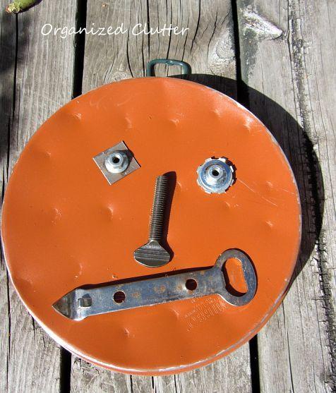 Pumpkin face garden decor made from junk