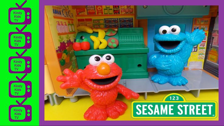 Sesame Street. Elmo, Cookie Monster toys, using play-doh with the Sesame...