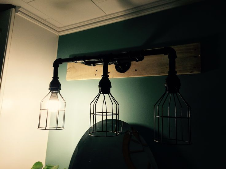 DIY piping light fixture in nautical bathroom