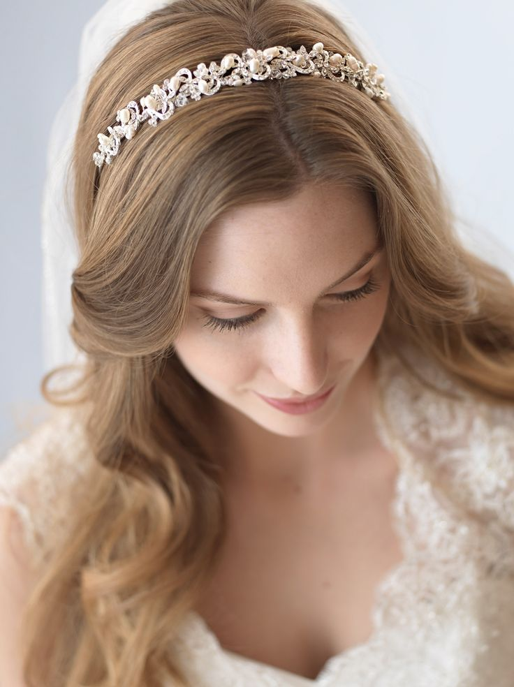 Top Seller! Bridal headband features hand-wired freshwater pearls and sparkling rhinestones in an elegant swirling design.