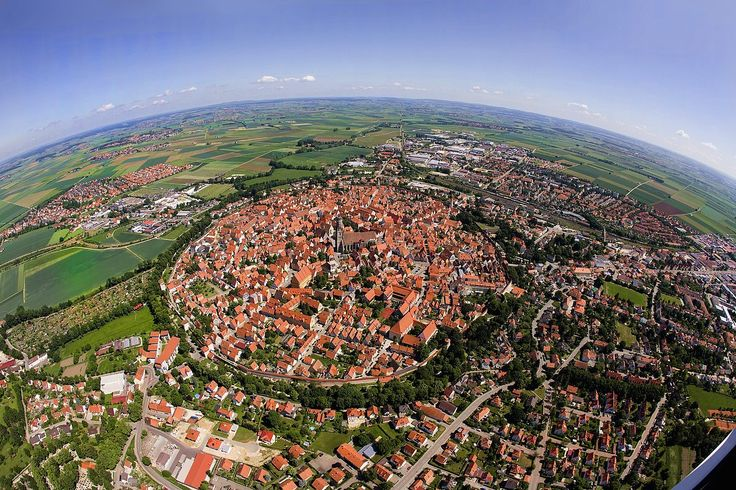 "Nördlingen (Germany) is a walled medieval town, set amidst a meteor crater that fell down 15 million years ago. It is located along the Romantic Road and it was featured in the ""Willy Wonka and the Chocolate Factory"" film."