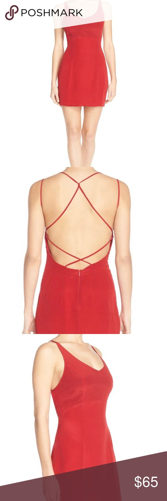 "Charlie Jade Red Silk Dress A festive red hue amplifies the sultry charm of this cocktail dress cut from luxurious silk and designed with an alluring open back with crisscrossed straps. - Sleeveless - Back zip closure - Strappy back design - Lightweight, non-stretch silk - Fully lined - Approx. 35.5"" length - Imported Fiber Content 100% silk  Dry clean charlie jade Dresses"