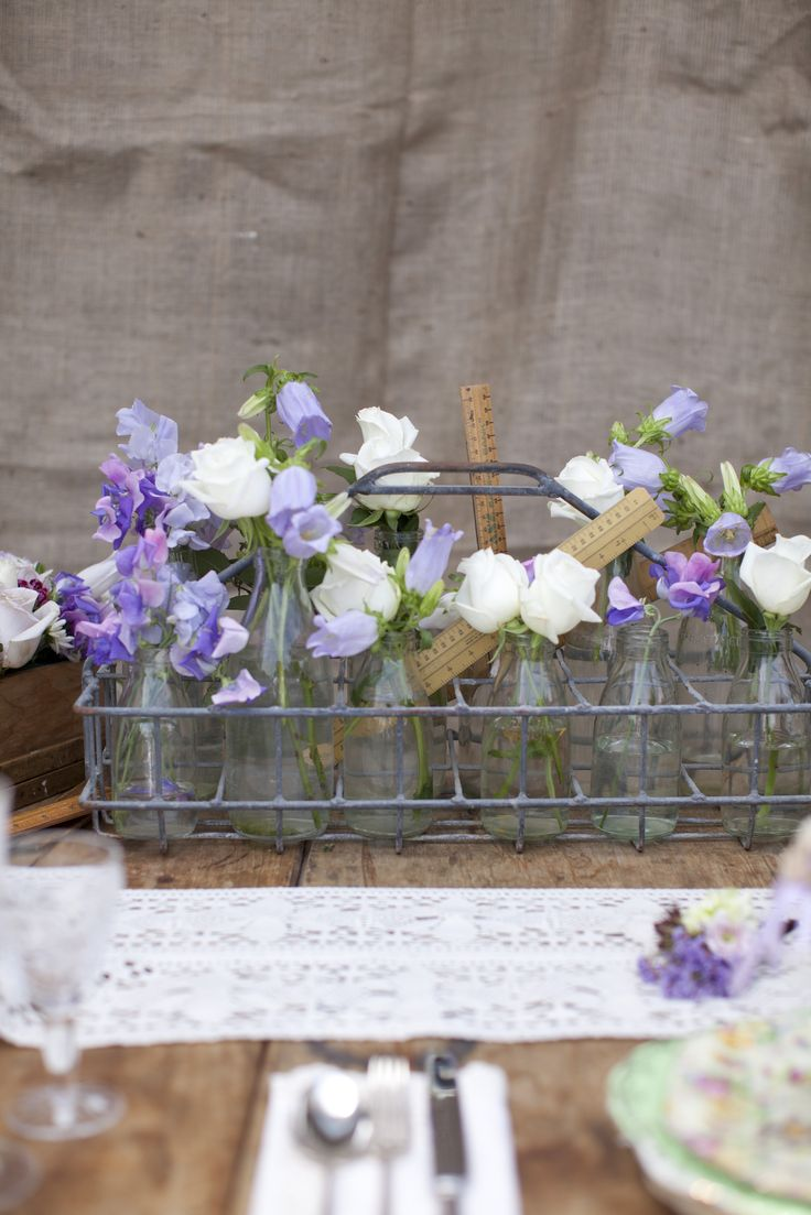 Put a new twist on old treasures and reinvent what you already own, such as wooden furniture, pottery, crates, glassware and homespun linens. New Zealand Weddings Magazine, Spring 2013 issue. Photography by Jimena Murray.