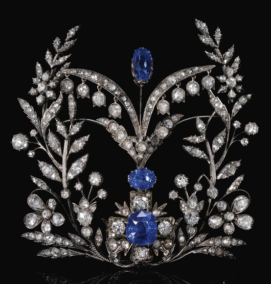 SAPPHIRE AND DIAMOND DEVANT DE CORSAGE, LATE 19TH CENTURY. Composed of floral and foliate motifs including lily of the valley, set with cushion-shaped and oval sapphires and rose diamonds, the cross motif later set with cushion-shaped and circular-cut diamonds.
