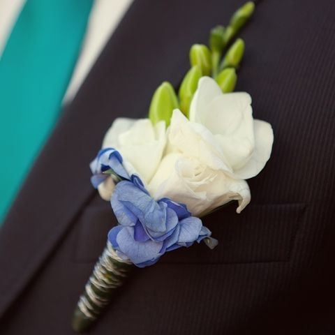 Touch of Blue - Lisianthus - Hydrangea Boutonniere | Wedding Boutonniere | Groom Boutonniere | Groomsmen Boutonnieres | Buy Boutonniere at BunchesDirect