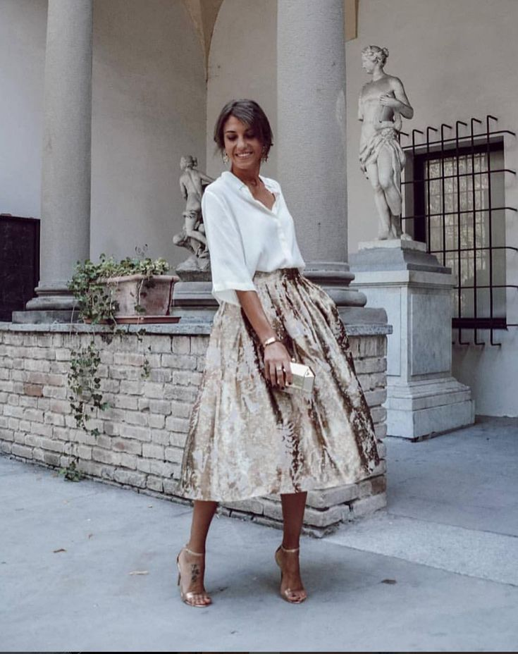 White shirt and golden skirt on excessive heel sandals