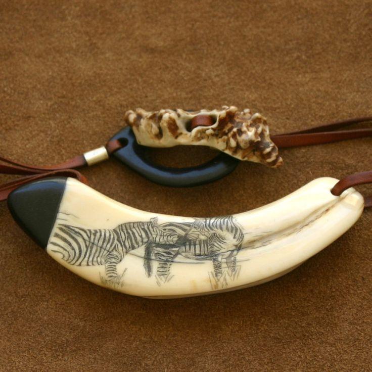 "Scrimshaw ""Zebras"" Warthog tusk scrimshaw engraving, ebony, kangaroo leather cord, german silver and pearl moose.  Measurement 5cm/2cm aprox. scrimshaw engraving, wider side.  Measure warthog tusk outside diameter 10cm.aprox  noemi rafel #b2zone"