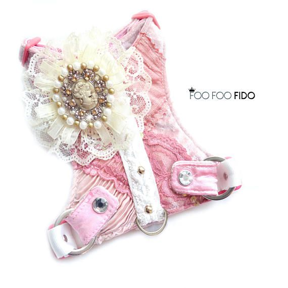 Pink Dog Harness Courtney Pink Velvet with silk dupioni patches, different shades of pink lace, cream crocheted lace with various pearl and rhinestone buttons, plastic slide buckles and rhinestone heavy duty snaps. Fully Lined and Hand Washable. You can add a fancy matching leash here: