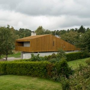 Schjelderup Trondahl Architects' Vardåsen House is topped with an angular timber…