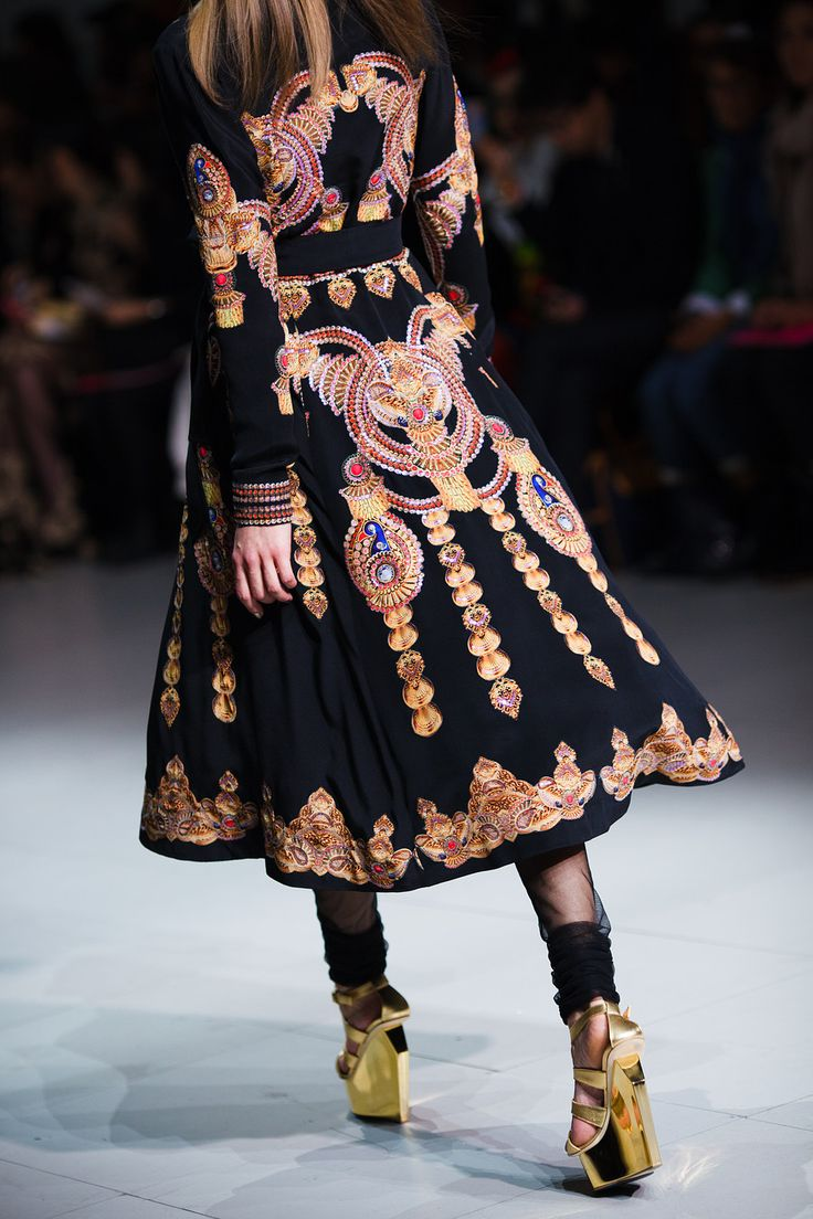I need this coat from Manish Arora , I love all of the ethnic aztec print pattern all over it - SOOOO CHIC