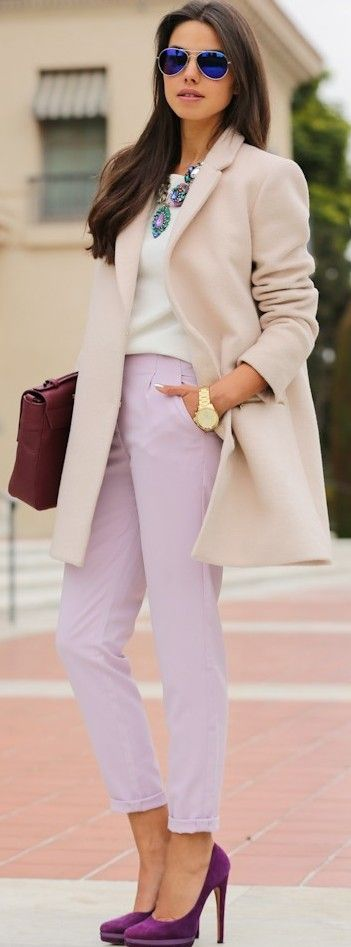 Very elegant. Creamy blush colored thigh length wool coat, no buttons for a smooth line. White shirt and mauve ankle grazers with deep purple stiletto pumps. Great color story. Squash blossom style necklace, briefcase, aviators, gold watch. Style Planet