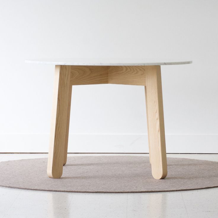 Ash and marble modern round dining table by KROFT. Stir Round, designed by Dustin Kroft, 2017.