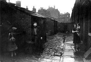 Wigan 1939: Back-To-Back ...And Shelters Against the Rain. He is 27. He is a miner by profession; but he has been nine years out of work. He lives in the Hardybutts - a row of slum houses which are to be replaced by council houses More than 2,000 council houses have been built; but there are still slums