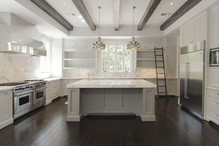 White marble countertops- white countertops and cabinets with dark flooring- Full height splash- must have the ladder!