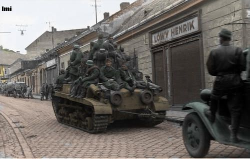 Hungarian Turán tank in the street, with a full load of infantry.