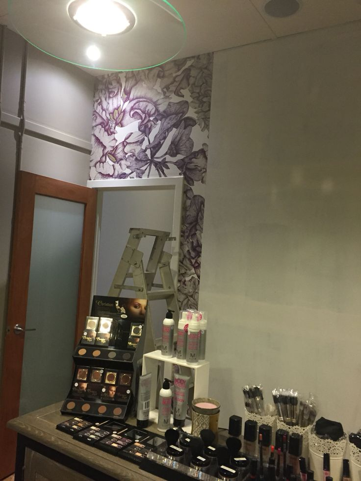 Putting up our beautiful new wall paper in the reception area.