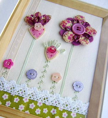 Make your own fabric flower picture with fabric, buttons and lace.
