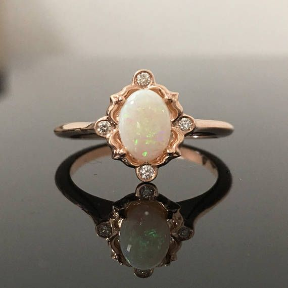 Hey, I found this really awesome Etsy listing at https://www.etsy.com/listing/533233793/rose-gold-opal-engagement-ring-14k-rose