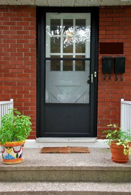 So remember this post back in May when I threw around some options for paint colours for our front door? And how I was trying to make it work with our uber-ugly brown screen door? The screen door that didn't match with our house numbers, mailboxes, or shutters? Well, I couldn't make a decision about … … Continue reading →