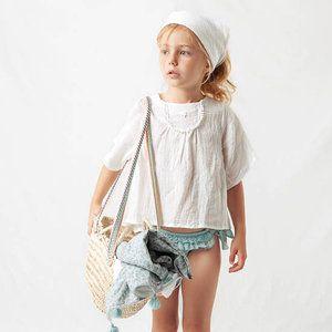 Oh lala, een must have zomer blouse van Tocotó Vintage!Sluit met knoopjes op de rug. Het is een losvallend model. Bestel bij twijfel een maat kleiner.     Geproduceerd in: Spanje  ...