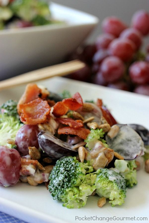 Broccoli – Grapes – Bacon – Sunflower Seeds – Sweet Red Onions – Salad Dressing – all wrapped up in a delicious package, what's not to love? This crunchy cold Broccoli Grape Salad Recipe is perfect for potlucks, cook-outs, and easy enough for a weeknight side dish!