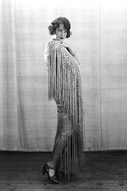Anyone with a smidgen of fashion history knowledge may think of fringe as a ubiquitous trend of the 1920s. The fringe frocks of this era — famously designed by Madeleine Vionnet — partnered closely with the dance craze du jour: the Charleston.
