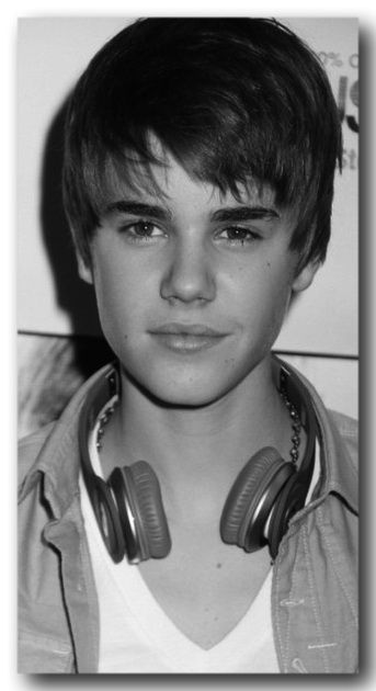 Justin Bieber the child phenom, this was when he was just a little guy trying to put on a little brawn and add to his height.