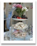 Tiered Tray with Shaped Tea Sandwiches, Home-made Cookies, Grapes and Fresh Strawberries