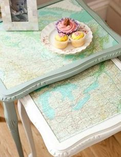 Upcycled old tables with new paint and decoupaged nautical charts. Find your chart at NOAA's website, then print the pdf of your special place.