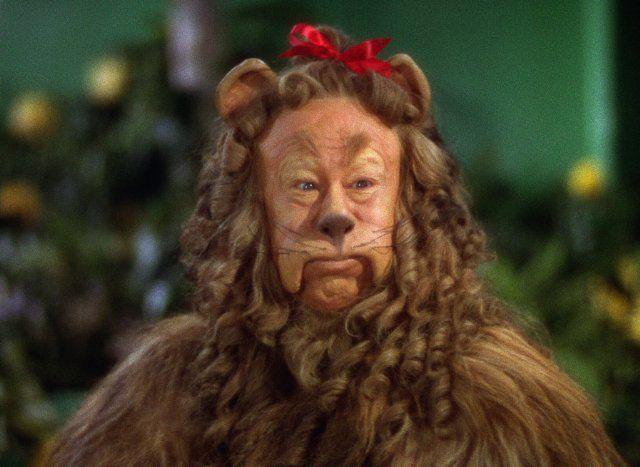 "Still of Bert Lahr in The Wizard of Oz ~  ""King of the Jungle"" ...even with the Red bow!"