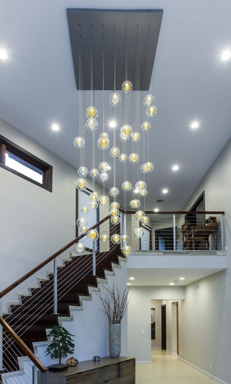 25 best two story chandeliers multi level chandeliers images on artisan made blown glass custom designed lighting drizzled glass threads hover suspended in midair caught within pristine glass orbs arubaitofo Images