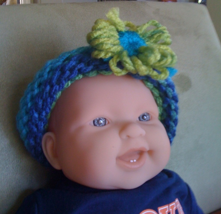 Knitted baby headband in shades of blue and green. $6.00, via Etsy.