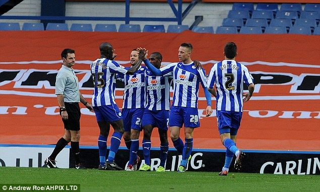 All smiles: Sheffield Wednesday players celebrate Connor Wickham's goal against Reading