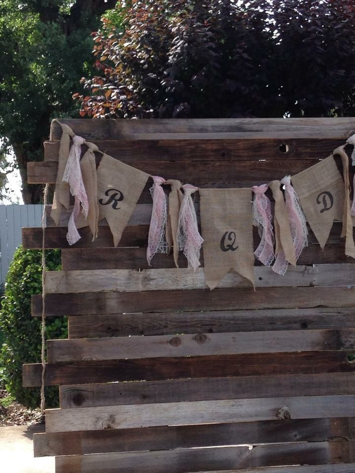 Wedding ceremony backdrop using reclaimed wood and burlap