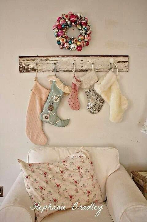 Hate the wreath but love the stockings hanging on wood since I do not have a fireplace.