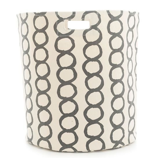 """A modern circle graphic in dark grey makes this large, durable woven cotton hamper a stylish storage solution for the laundry room, bedroom, closet, or kids spaces. Part of our exclusive collaboration with Pehr Designs, Pilar coordinates with any of our shale C3 bedding and bath accessories, including towels, shower curtains, bath mats, and window panels.   • 100% cotton.  • 18"""" x 20"""".  • Screen printed.  • Circular bin with 1 seam and built-in handles."""