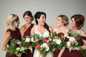Bridesmaids laughing together. Burgundy bridesmaids dresses. Wine and coral bouquets. Berkeley Church Wedding, Toronto Wedding Photographer. #sweetheartempire #berkeleyevents #benviv