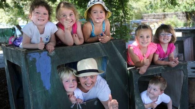 Hanan Kindy kids, from top left, Candice Holden, 4, Romy Welch, 3, Samara Kini, 3, Maddison Fairbrass, 4, Amy Diehl, 4, and Jill Connor with Noah Tyler, and Mason Norton, 3, are smiling again after the kindergarten was flooded with offers of support to make up for the theft of playground equipment.